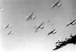 old, black and white photo of bomber planes flying in a clear sky