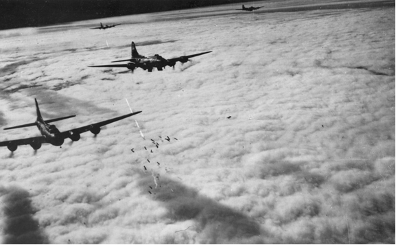 B-17 bombers flying in formation over complete cloud cover