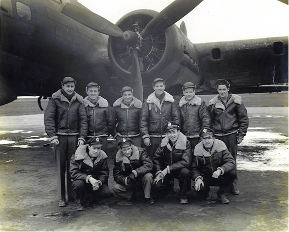 first crew to bomb Berlin posing in front of aircraft
