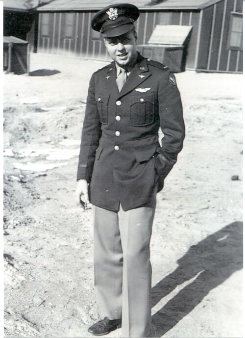 black and white photo of young man in Air Force uniform outdoors in winter