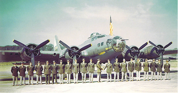 officers of the 92nd bomb group posing formally in front of bomber aircraft