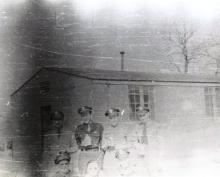 Officers of the 482nd BG with canteens outside their barracks