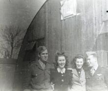 Officers of the 482nd BG have picture taken with Red Cross women - Alconbury